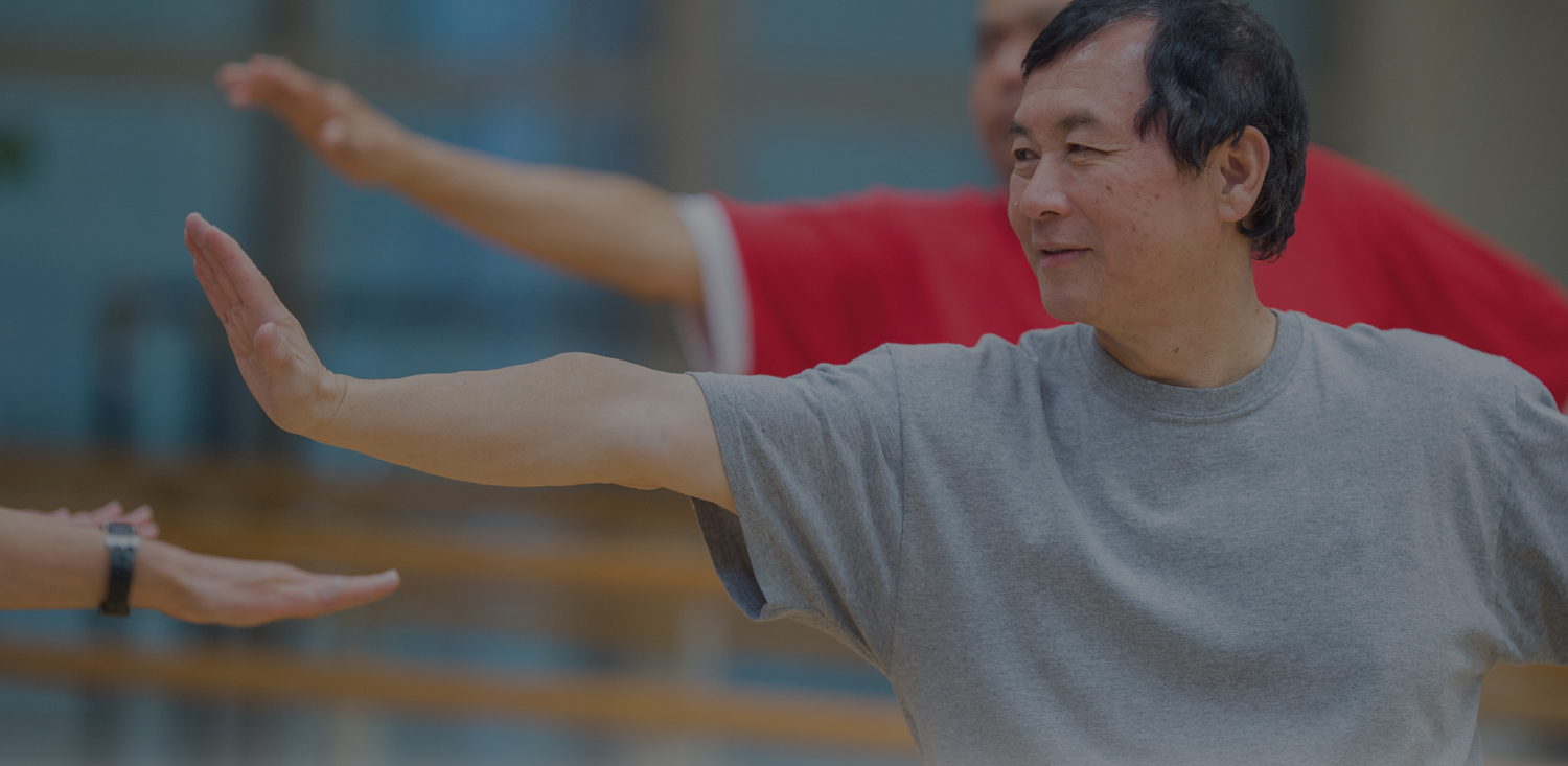 Senior Asian man practicing Tai Chi at Broward Health