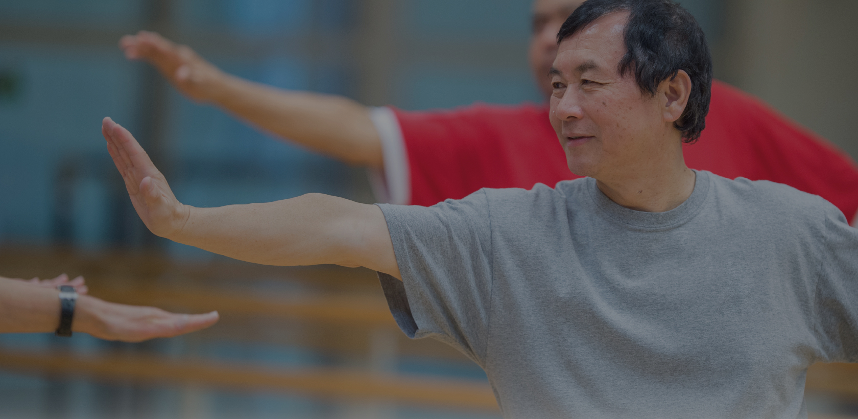 Senior Asian man practicing Tai Chi